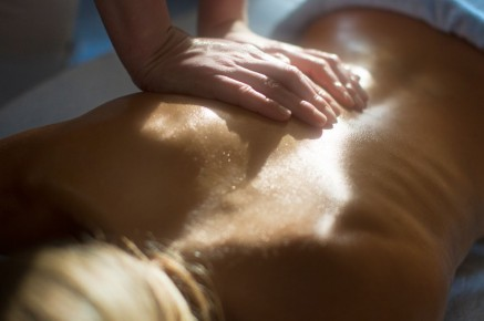 Massage with warm essential oils